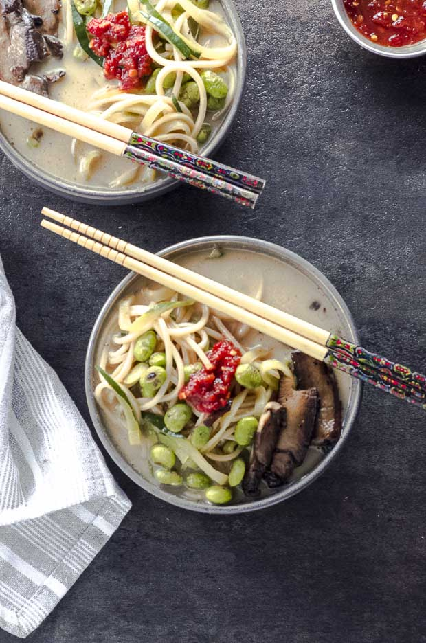 bird's eye view of two bowls of coconut miso ramen noodle soup