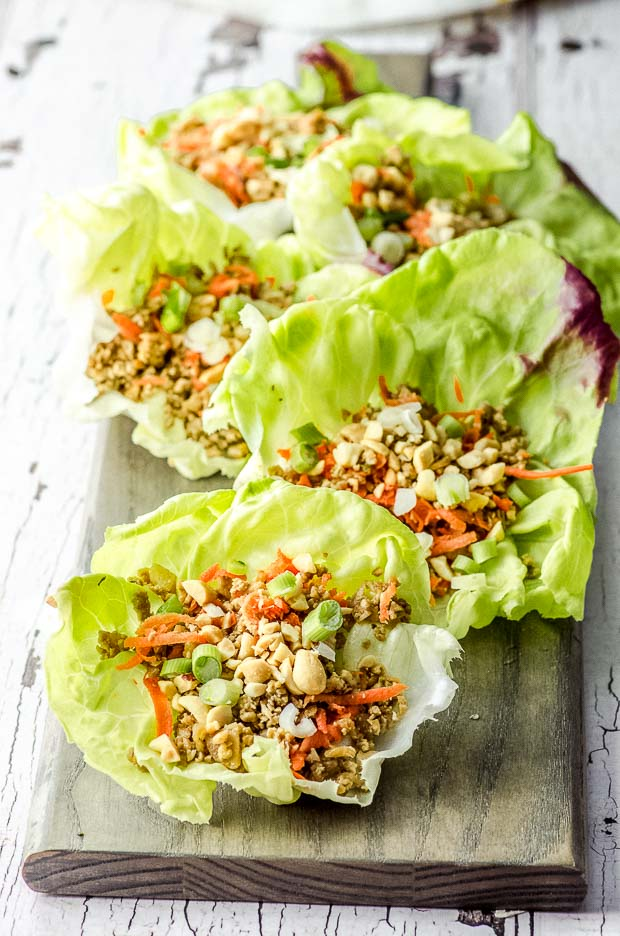 Several vegan lettuce wraps on a wood board