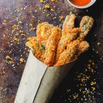 Buffalo Eggplant fries in a paper cone