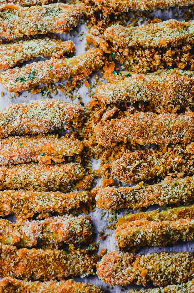 Buffalo Eggplant Fries in a baking sheet