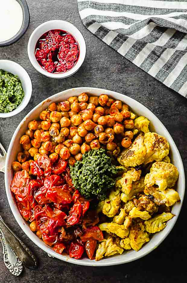 bird's eye view of a roasted chickpeas and cauliflower bowl