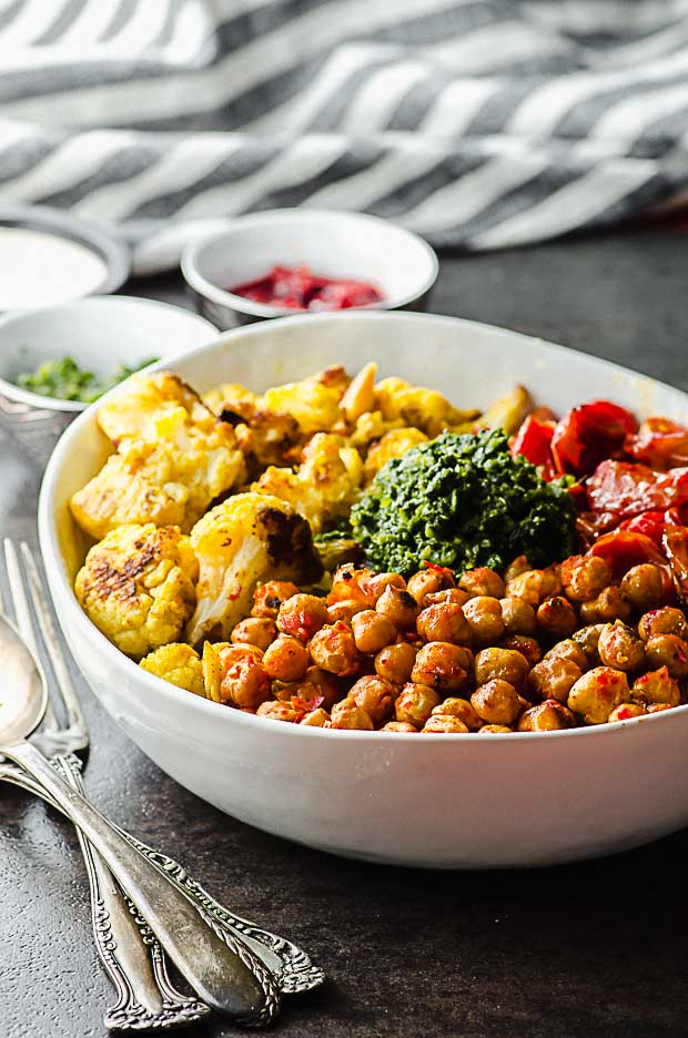 side view of view of a roasted chickpeas and cauliflower bowl
