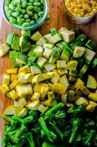 Diced zucchini, yellow squash, broccoli, edamame and corn for quinoa fried rice
