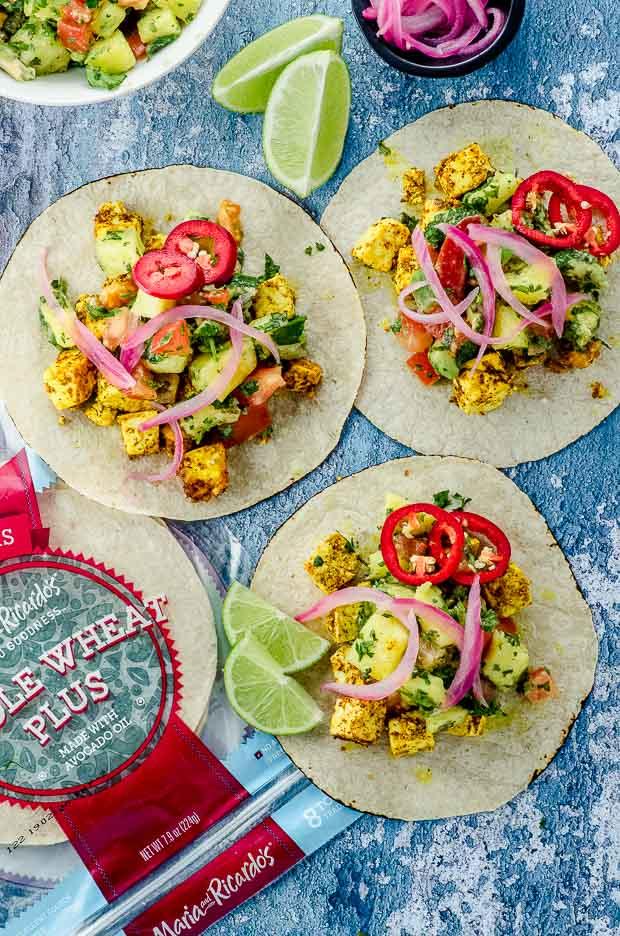 Bird's eye view of vegan tacos al pastor made with tofu, with Maria Ricardo's tortilla Packaging