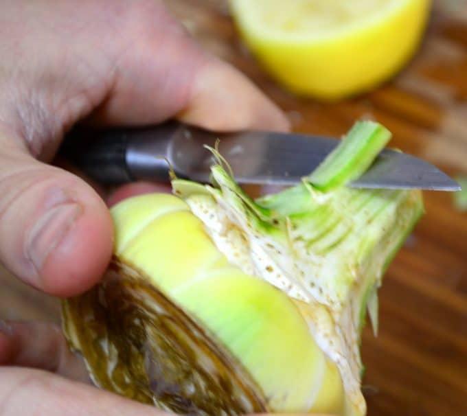 peeling an artichoke heart
