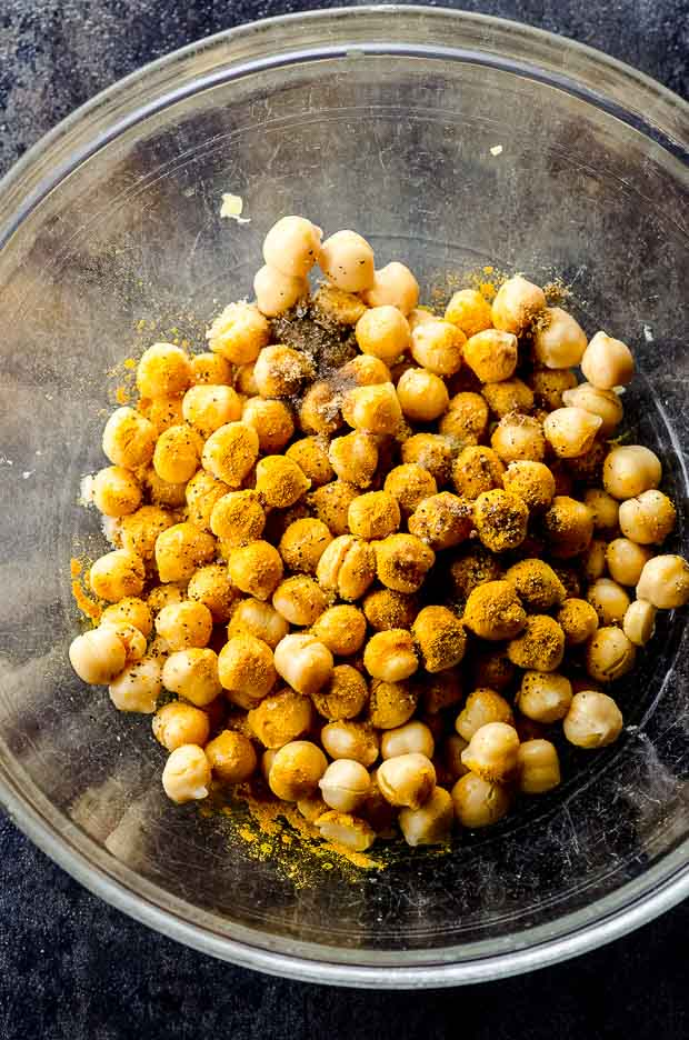 A bowl of chickpeas with spices to make a chickpea salad