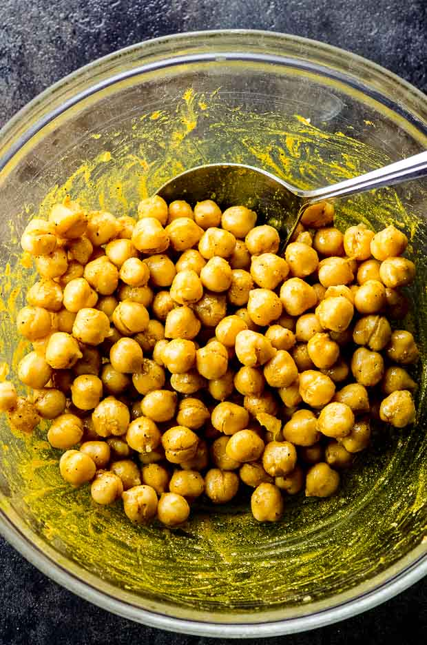 A bowl of chickpeas with mixed spices for chickpea salad