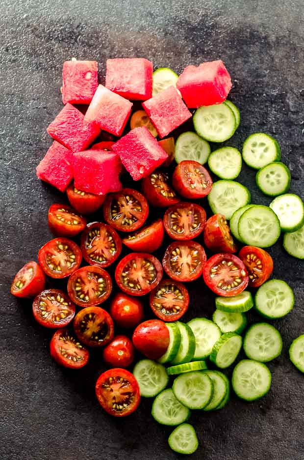 Ingredients for a watermelon salad, watermelon, cucumbers and tomatoes