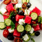 Close up view of a cucumber feta watermelon salad