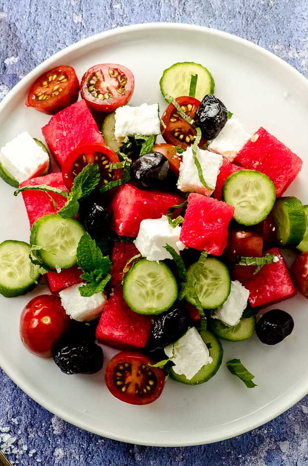 Close up view of a cucumber feta watermelon salad