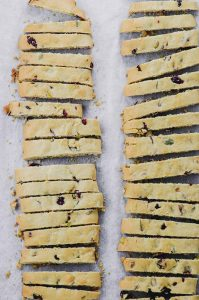 cranberry pistachio baked biscotti dough cooled and sliced
