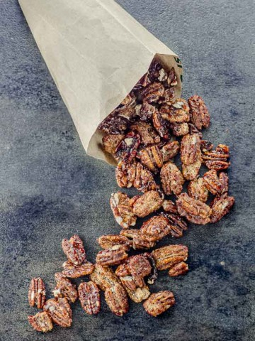 Candied pecan coming out of a paper cone