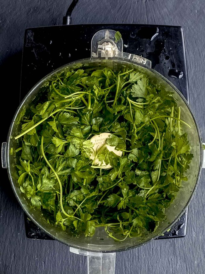 Fresh parsley in the bowl of a food processor