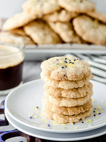 closeup view of a white plate with stacked vegan butter cookies