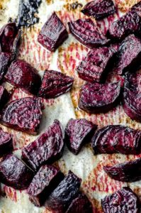 Roasted cuts beets on a baking sheets