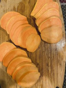 Sliced sweet potatoes to make sweet potato fries