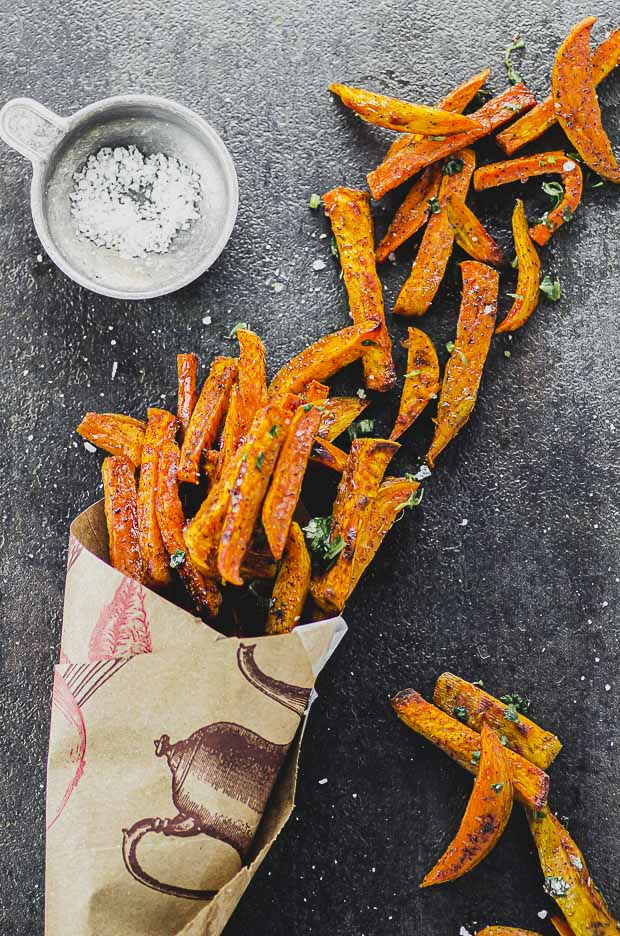 Sweet potato fries in a paper cone. One of our vegetarian Passover recipes.