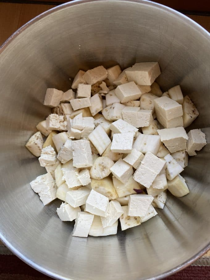 A bowl filled with diced tofu