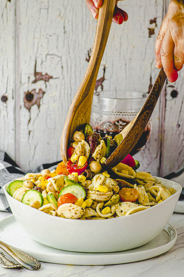 Tossing the ingredients of a pasta salad