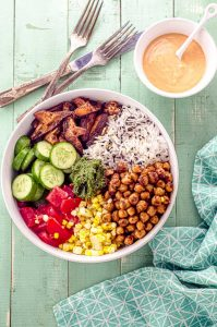 Bird's eye view of a sharama chickpea and mushroom nourish rice bowl