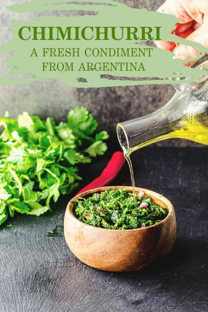 Pouring oil on a wood bowl of Chimichurri