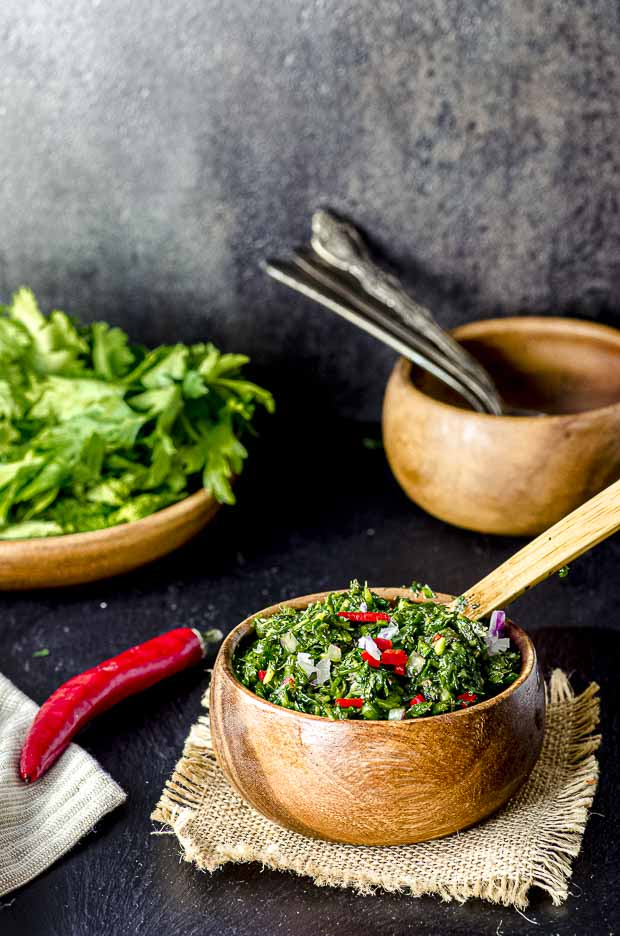 Side view of a wood bowl with Chimichurri