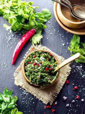 Bird's eye view of a wood bowl with Chimichurri sauce