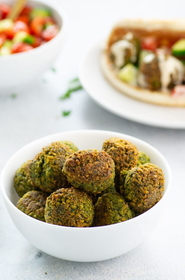 A white bowl filled with falafel balls