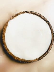A filled graham cracker crust with vegan key lime custard