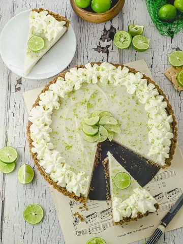A key lime pie with a slice cut out