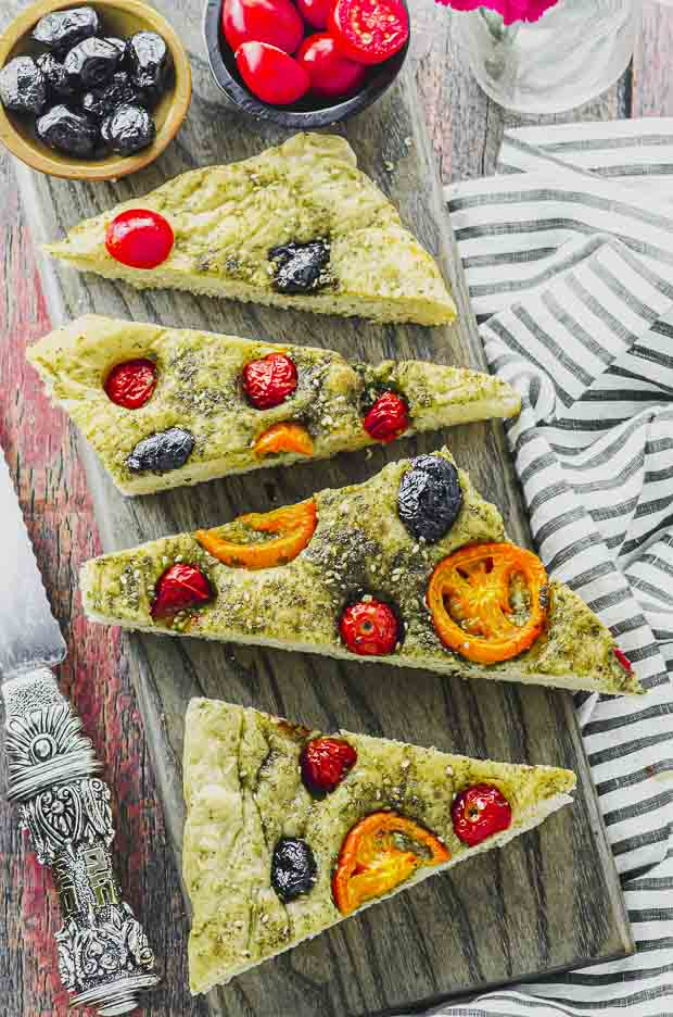 Overhead view of Focaccia slices on a wood board