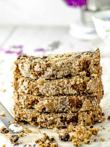 A close up view of 4 zucchini bread slices piled vertically