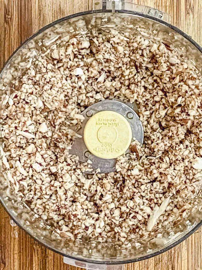 Chopped shiitake mushrooms in a food processor bowl