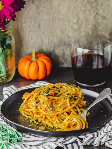 Side view of a plate of spaghetti with pumpkin pasta sauce
