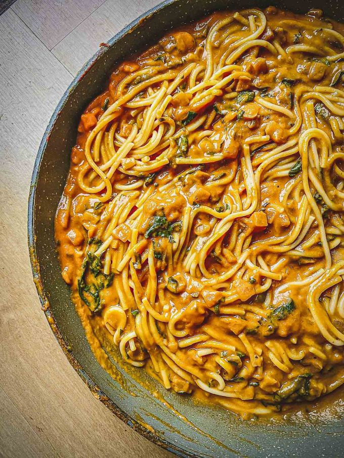 Adding cooked pasta to the pumpkin sauce