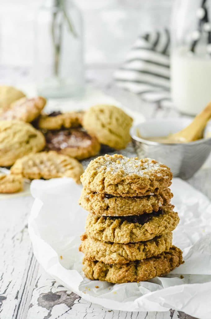 5 peanut butter cookies piled on a piece of parchment paper