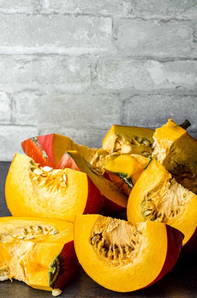 A whole cinderella pumpkin cut in wedges