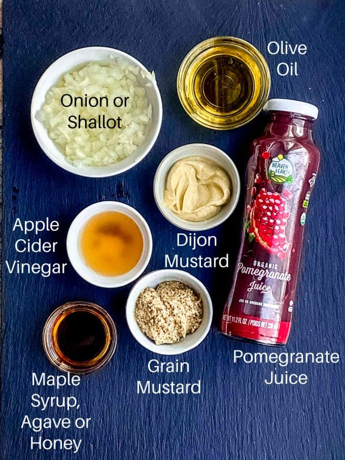 Pomegranate Vinaigrette Ingredients Labeled: Onion or shallot, Olive Oil, Apple Cider Vinegar, Maple syrup, grain mustard, dijon mustard and pomegranate juice