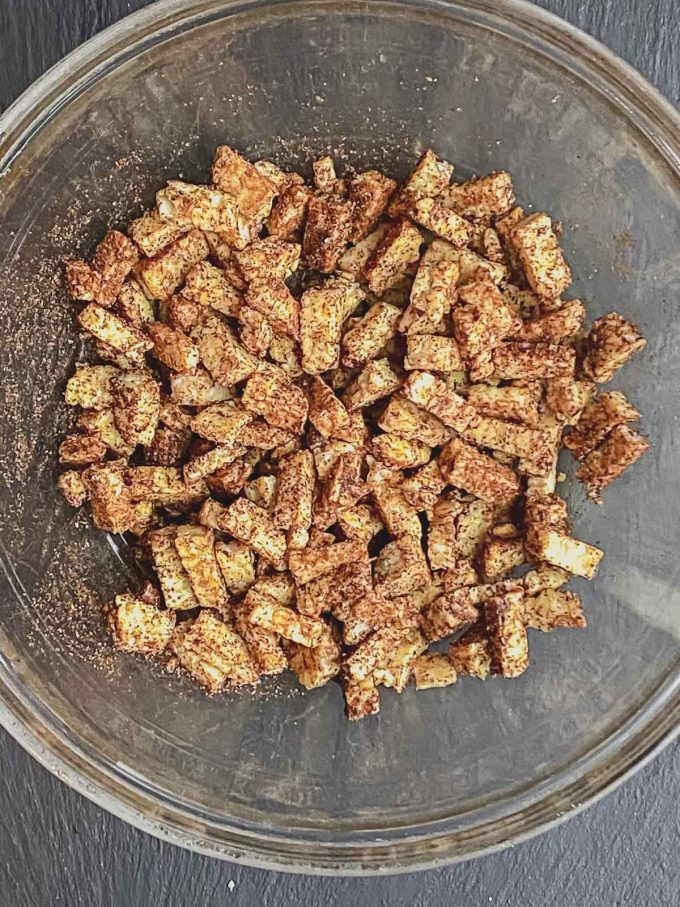 tempeh pieces in a bowl with spices