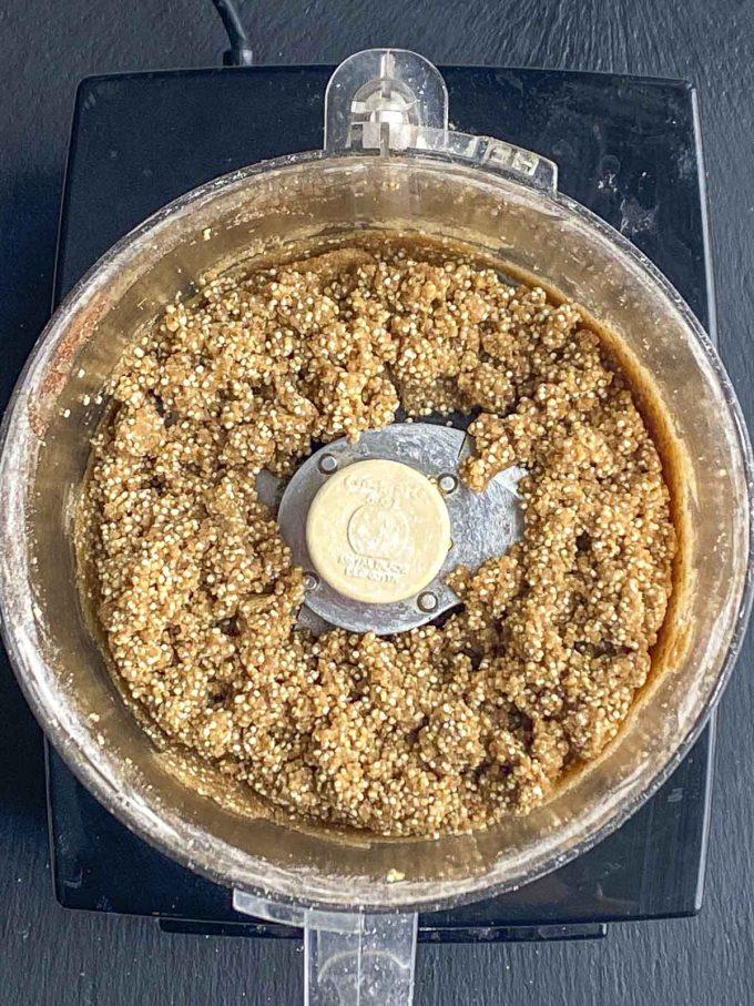 Quinoa breakfast cookie batter in a food processor cup