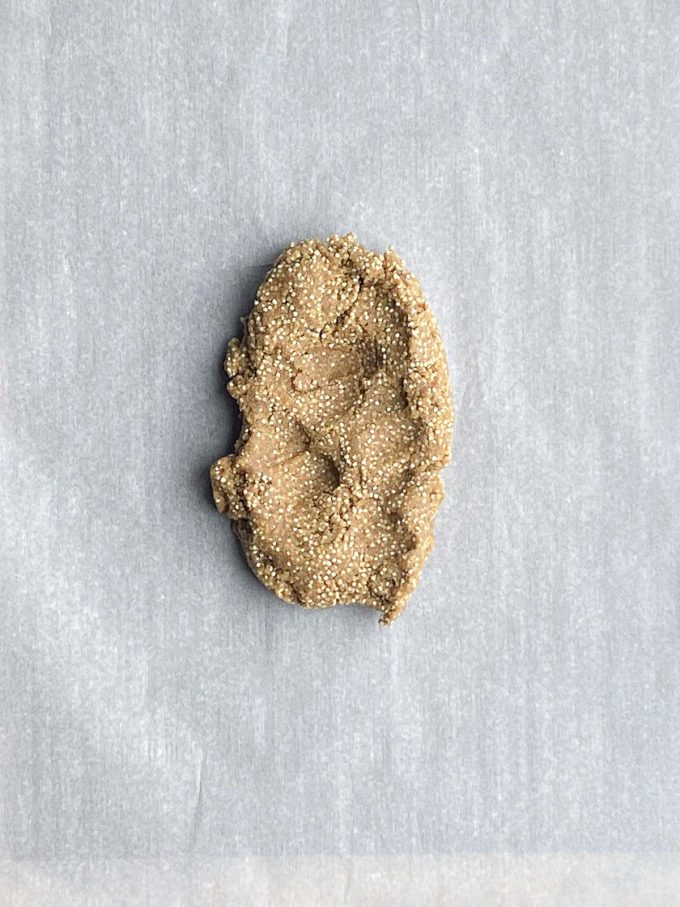 Quinoa breakfast cookie dough on parchment paper