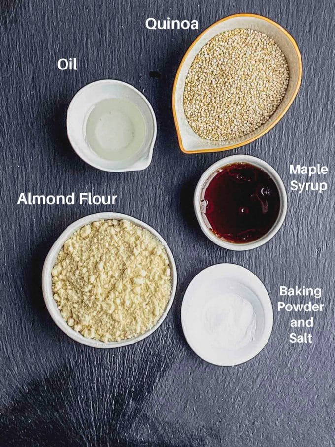 Quinoa breakfast cookie ingredients labeled. Quinoa, almond flour, oil, maple syrup and baking powder