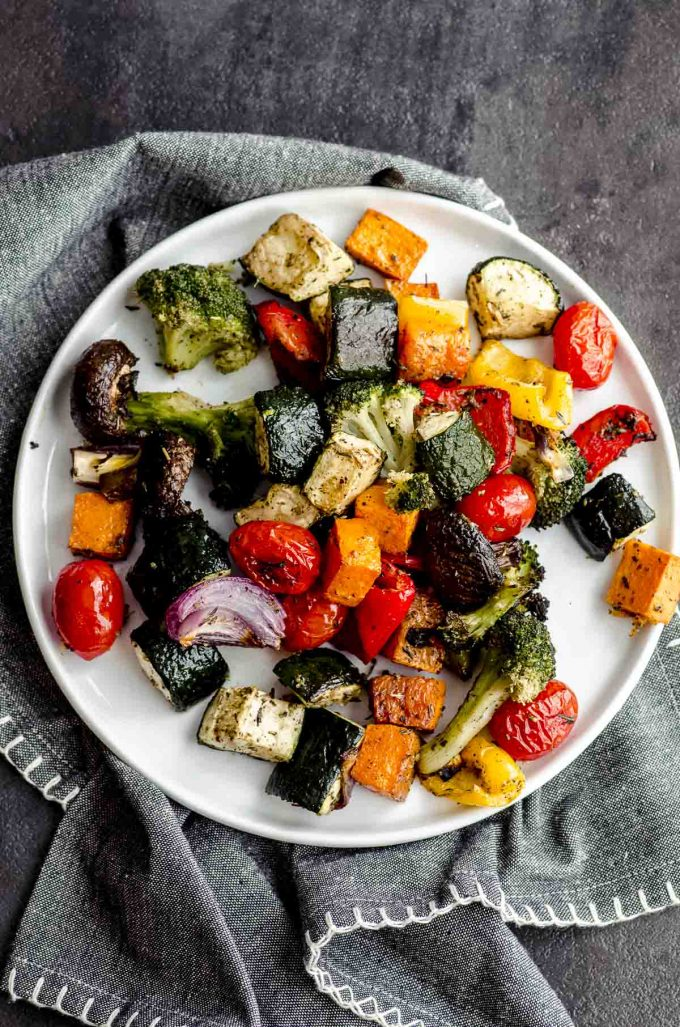 Oven roasted vegetables on a white plate