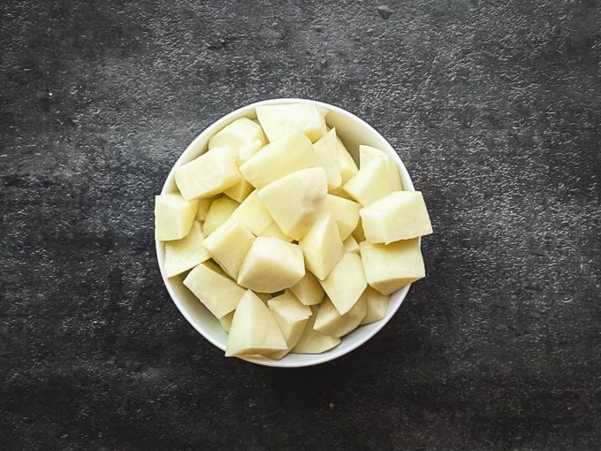 a bowl of diced potatoes