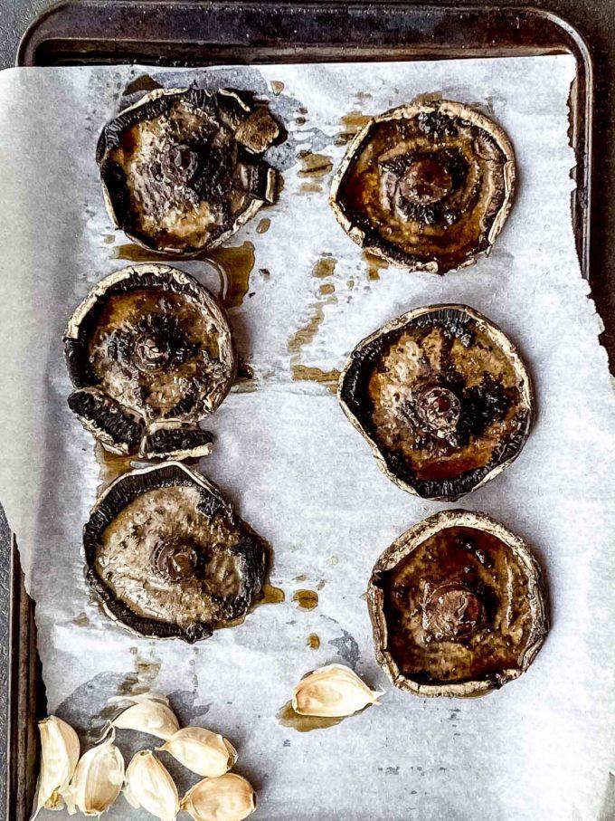 Roasted portebello mushrooms on a baking sheet