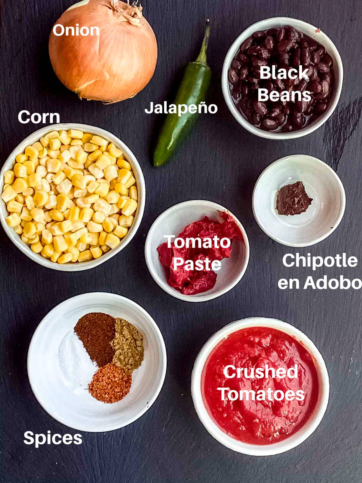 Overhead view of the labeled ingredients to make tortilla soup