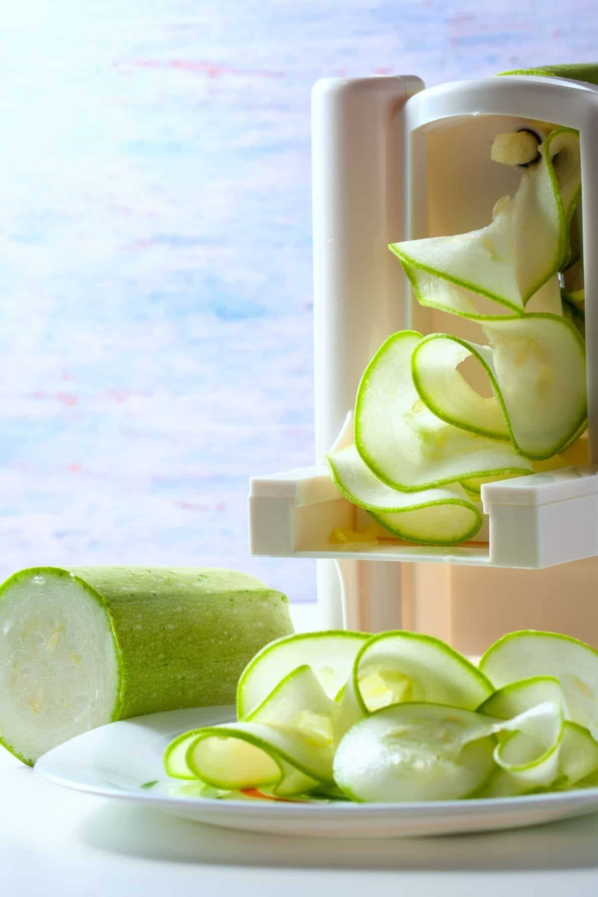 Making zucchini ribbons with a spiralizer