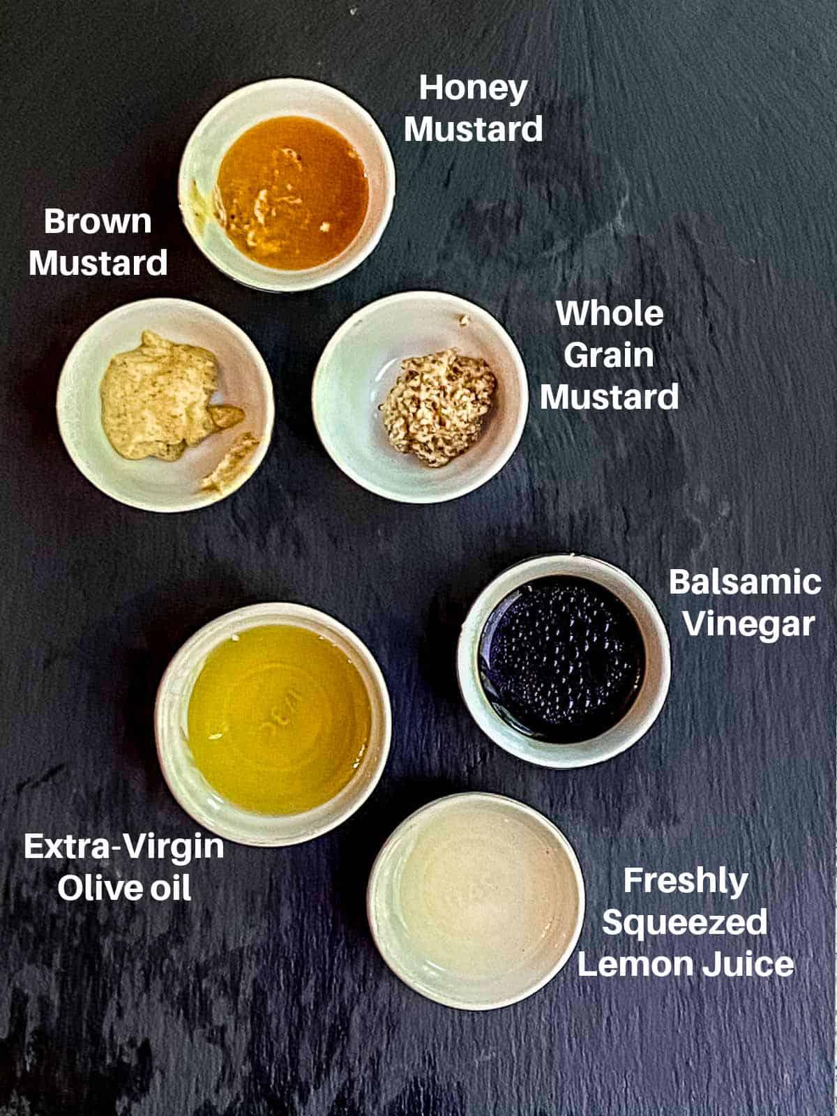 ingredients for balsamic dressing labeled: honey mustard, brown mustard, honey mustard, balsamic vinegar, olive oil, lemon juice