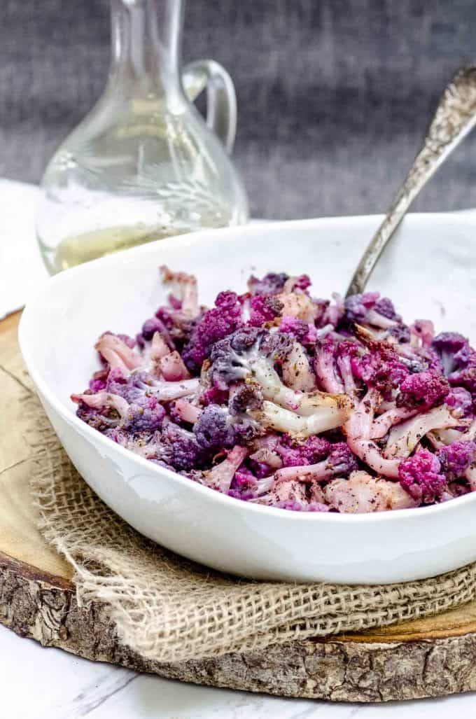 close up view of a bowl of roasted purple cauliflower
