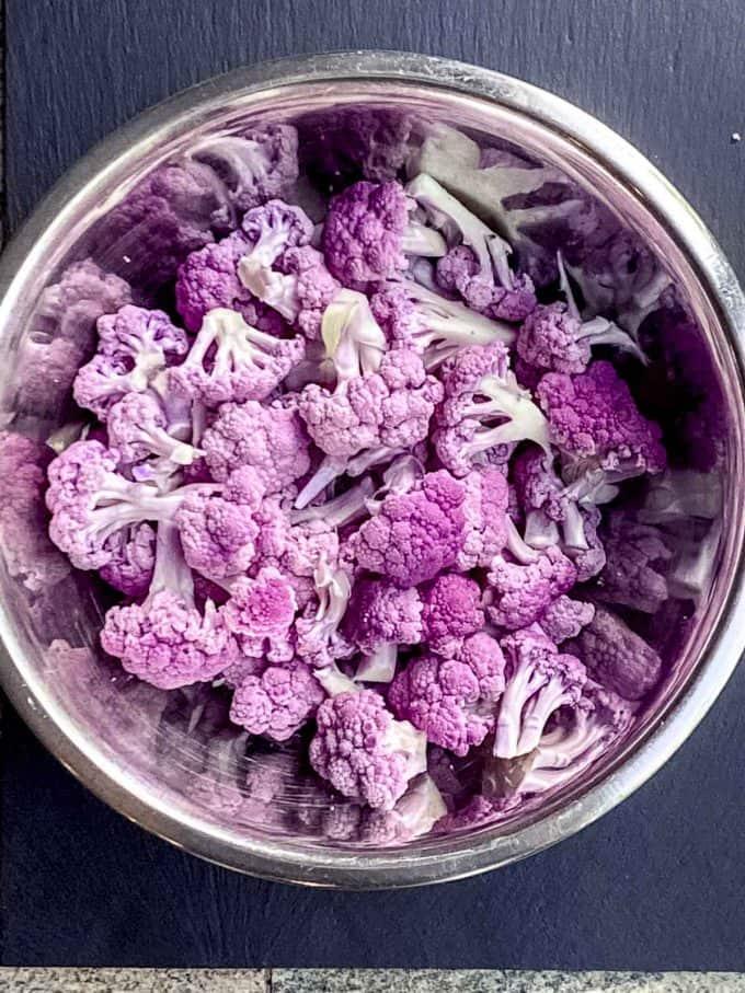 Bite-size cauliflower florets in a metal bowl